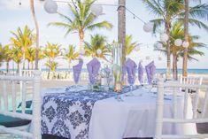 Purple decor at beach reception - Destination beach wedding at Riu Yucatan in Playa Del Carmen, Mexico / Ashley & Chris Real Wedding - WeddingVacations.com