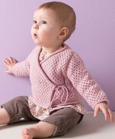 Free Knitting Pattern for 4 Row Repeat Baby Wrap Jacket - This crossover wrap cardigan features a 4 row repeat lace stitch. for newborns in stockinette stripes. Sizes Newborn, 3 months, 6 months, 12 months, 18-24 months. Designed by Phildar Design Team