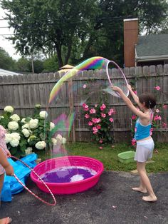 Wet and wild party giant bubble fun!  This solution is 10 gallons of distilled water, 10 cups of original Dawn and 30 drops of glycerine (Amazon).  The photo says it all!