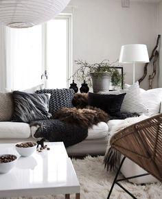 white couch, fuzzy carpet, dark pillows