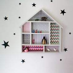 Little House - We decorated our little dolls house shelves with mini Isak, Ferm Living and Farg Form wallpapers. The house is £19.95 and perfect for displaying knick knacks and keepsakes in the nursery (or any room!). Ferm Living black star wall stickers £11.95. If you'd like to decorate your own we'll happily email you the PDFs to print at home.