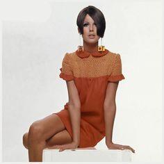 Model in orange mini dress Photo Bert Stern Model wearing orange high-yoked linen dress from Lynn Stuart and plastic earrings 1966 Condè Nast Archive