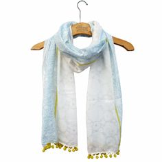 Disaster Designs Carnaby Stripe Scarf: A pretty white, soft grey and pale blue printed floral scarf with pom pom trim in yellow.  A lovely accessory to cheer up your outfit!