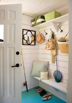 Casual Cottage Entryway In this Laurentians, Que. cottage, a cramped mudroom feels larger thanks to white paint and a teal painted floor. Homeowner Heidi Smith installed the hooks and shelving herself for convenient storage. Decor, Mudroom, Cottage, House, Interior, White Cottage, Home, Cottage Entryway, Cottage Homes