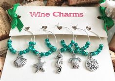 Check out this item in my Etsy shop https://www.etsy.com/listing/454813994/beach-wine-charms-beach-wedding-favors