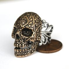 Skull ring - http://www.etsy.com/listing/78879457/bronze-sugar-skull-cocktail-ring