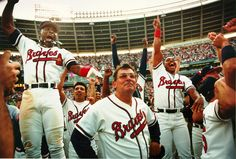 1991: Atlanta Braves manager Bobby Cox, along with Ron Gant and Brian Hunter watch San Francisco beat the Los Angeles Dodgers on the vast television screen high above Atlanta-Fulton County Stadium which gave the Braves the National League West Championship after their 5-2 victory over the Astros. (FRANK NIEMEIR / AJC File)