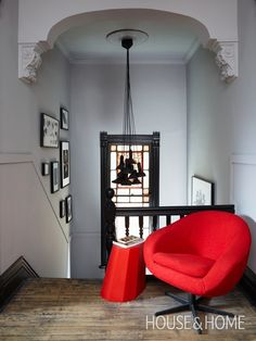 Mixing Trad & Modern Design + Decor | Designer: Stéphane Chamard | Photographer: Michael Graydon | #interiordesign #homedecor #armchair #lightfixture #hallway #staircase