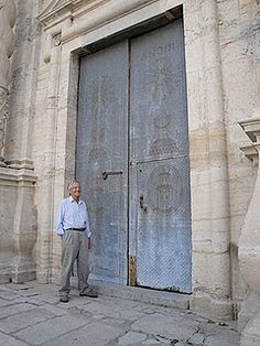 The doors to some of the churches in Spain are gigantic. This one is pounded metal.