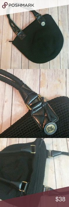THE SAK bucket crochet bag Black bucket style bag with wrapped straps. Leather derail at base of straps. Zipper closure. Lined. Great condition The Sak Bags