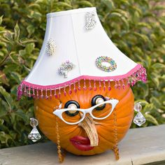 Aunt Hattie  ~  With a little dress-up fun, you can raise a whole wacky pumpkin family to welcome guests to your home.