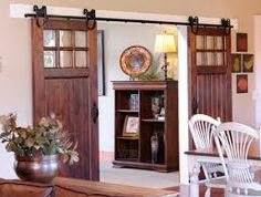 Installing interior barn door hardware can transform the look of your room. Read these steps in buying interior barn door hardware. Interior Sliding Barn Doors, Sliding Doors, Half Doors, Room Divider Doors, Room Dividers, House Doors, Barn Door Hardware, Rustic Hardware, French Doors