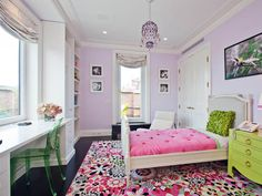 Aubrey's new room idea. Her bedding is similar to the rug. And she wants a green dresser