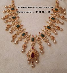 Get the best designs at 50 wastage charges comparing to most of the jewellers. Visit for ready selection of latest variety or made to order jewellery. Presenting here is a Emeralds and Czs Bridal necklace 80 gm Gwt. Contact no 8125 782 411 for orders .