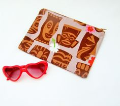 Kitsch cosmetic bag, make up bag, tiki head print, hawaiian print bag, retro kitsch tote, hula girl fabric, palm tree bag, retro holiday bag by Kitschosaurus on Etsy