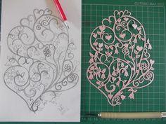 Original, hand drawn, folk style heart papercut by Nina Byers