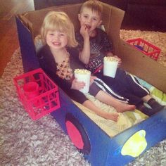 Every Friday night is movie night at our house and mom got creative and made a drive in movie box car!