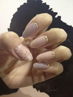 blush and nude nails with gold bling