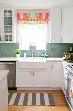 Kitchen with Roman window shade, rug, and farmhouse sink
