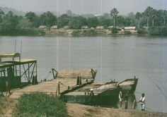 Ferry on the Ubangui River at Bangassou, the border between Zaire and C.A.R; the only way in or out ot Zaire