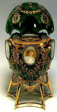 1908 - Alexander Palace Egg  Nicholas II presented it as an Easter gift to his wife, Alexandra Fyodorovna.  The surprise is a detailed replica of the Alexander Palace, the Russian Imperial family's favorite residence in Tsarskoye Selo.