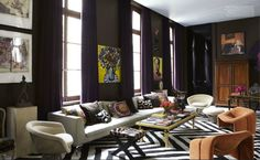 deep purple walls and drapes in Sig Bergamin's Paris living room.