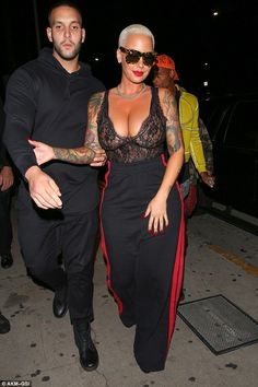 db3de4b785ac4 Taking the plunge  Amber Rose showed a tonne of cleavage as she hit  Halloween party in Santa Monica on Saturday night