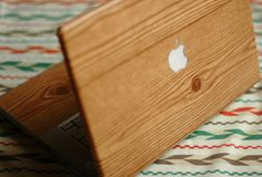 DIY Wood-Grain Laptop Wrap using contact paper.