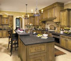Kitchen in Toledo, OH. Designed by Jennifer Diehl with Design Classics in Toledo, OH. Fieldstone Cabinetry Glen Cove door style in Maple finished in Oregano with Chocolate glaze.