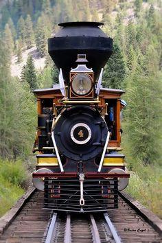 Eureka N° 4 of the Eureka and Palisade Railway crosses a trestle in Colorado. Eureka is a 3-foot gauge Baldwin 4-4-0 steam locomotive.
