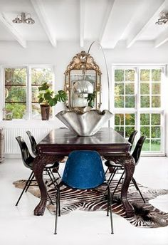 .traditional table w/ contemporary chair = fun
