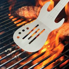 BBQ Rocks Guitar Grill Spatula  - $29.99 - Are you passionate about your BBQ and do you love to listen to music while barbequing? Live out your dreams of being the first BBQ Chef with a Rock Band! Classic tools designed with a theme to bring the joy of BBQ's to life with electric guitars and a microphone for the wanna be pop star! Are you guys ready to Rock?