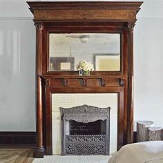 The flared crown that tops this fireplace overmantel forces the gaze to pan up to the molding above, making the 9-foot ceiling appear higher.   Photo: Wendell T. Webber   thisoldhouse.com