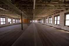 Warehouse. I would put either a big wood shop in here, or a dance studio.