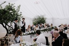 Foliage Marquee Wedding Decor - Off Shoulder Pronovias Wedding Dress For An Elegant Marquee Wedding With An All White Colour Palette Stationery by Old English Company Images by James Corbett