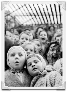 Children watching story of St. George & the dragon at puppet theater in Tuileries, in 1963. LIFE Magazine, by Alfred Eisenstaedt,