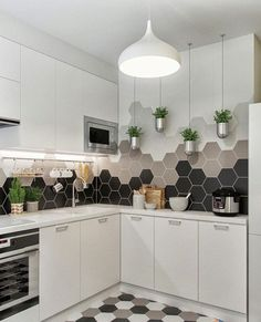 stunning ombre mosaic tiles on the walls and geo pattern on the floor
