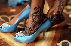 Nigerian Traditional Engagement - BellaNaija.   Henna on the bride's hands and feet.