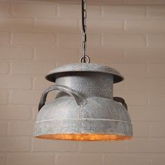 Milk Can Zinc Pendant This one-of-a-kind pendant light has a weathered zinc finish. It is wire with one standard socket of 150 watts maximum. This light comes wire and chain for hanging, as well as