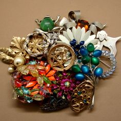 Google Image Result for http://charmchatter.com/wp-content/uploads/2011/12/Vintage-Jewelry-Pins.jpg