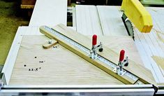 A swiveling arm and multiple pre-set stops enable this table saw sled to cut miter angles quickly and accurately. Table Saw Sled, Table Saw Jigs, Chop Saw, Sliding Table, Carriage Bolt, Garden Lanterns, Miter Saw, Wood Screws, Small Tables