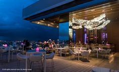 Bangkok's latest rooftop restaurant-slash-bar sits on the 26 floor of the new riverside Avani hotel. The big, well-stocked bar stands up front among outdoor tables, offering both classic and refreshing signature drinks like the Moulin Rouge (Absolut raspberry, passion fruit, touch of grenadine and topped with prosecco, B380).