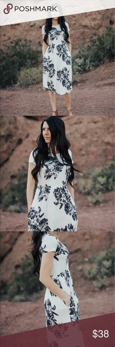 Floral fitted waist midi dress with pockets Ivory with accents of black/grey floral patterns. I am 5'9 wearing a size small. Small (0-4) Medium (4-8) Large (8-12) 95% Rayon 5% Spandex Dresses Midi