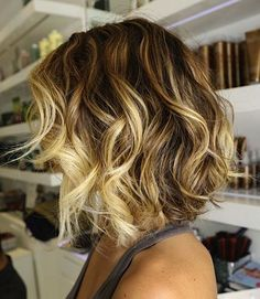 Long-ish asymmetrical bob with ombre coloring and soft, pretty styling. Maybe not asymmetrical