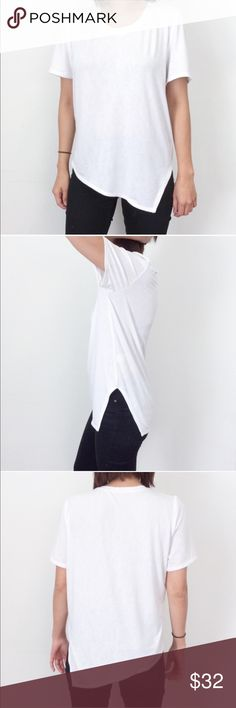 Atid Playcool Tee in White This is the perfect everyday Tee with a modern update. So easy to dress up or down. It's so soft you will want to wear it to bed! Atid Clothing makes high quality basics and wardrobe essentials.                                                                        ✖️Loose fitted with an asymmetrical hem and side slit. Jersey: 94% Rayon 6% Spandex.                       ♥️Made with love in LA♥️                                                ❌Price is firm unless…