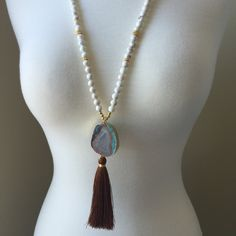 Creamy white turquoise beads with azure blue & brown ocean jasper pendant, accented with a mocha tassel.