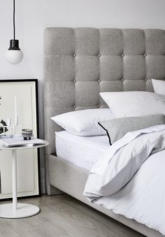 This grey headboard is so minimal and gorgeous.