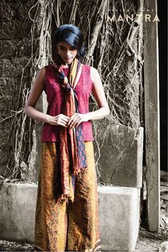 #Palazzo pants in panels of rich #Kalamkari is lined with strips of earthy block prints and Zari. A simple Kalamkari, sleeveless #kurta in a lovely shade of maroon, maintains the earthiness, yet keeps it young! A stole that combines the beautiful tones found in both garments, brings this ensemble together.