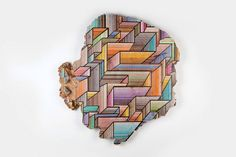 Jason Middlebrook is an artist who paints graphic geometric patterns on salvaged pieces of wood. These contemporary illustrations create a stunning contrast with the raw aspect of the wood. His artwork is currently displayed at Peters Projects, Santa Fe.