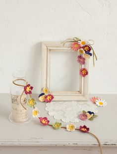 love love love these...  reminds me of my Grandmother... dainty, delicate, feminine...  definitely want to make some, and love the frame idea...